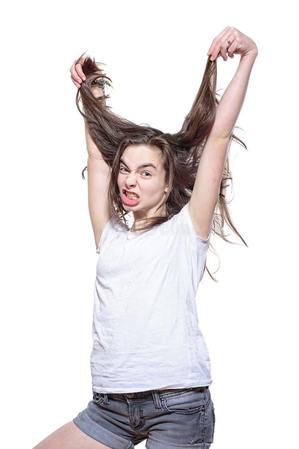 Adolescente forçado que retira seu cabelo imagens de stock royalty free