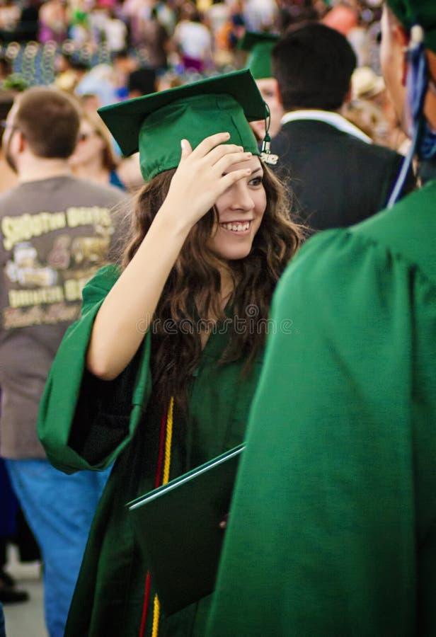Adolescente graduado feliz foto de archivo