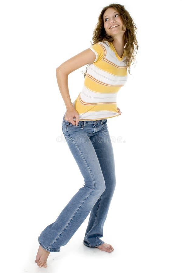 Adolescente hermoso en pantalones vaqueros foto de archivo