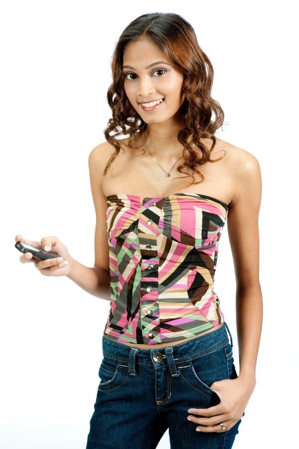 Adolescente indiano com telefone imagem de stock