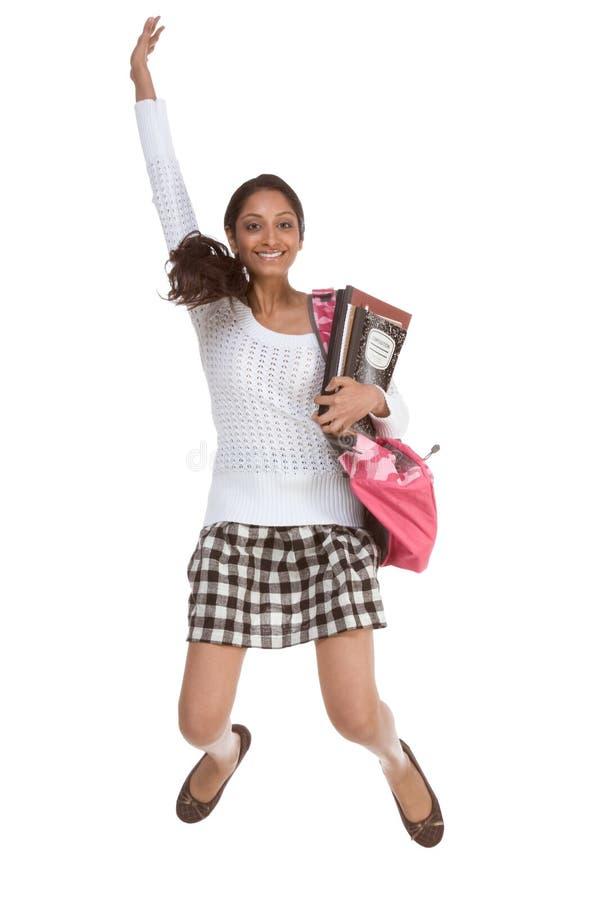 Adolescente indio del estudiante universitario con el salto del morral imagenes de archivo