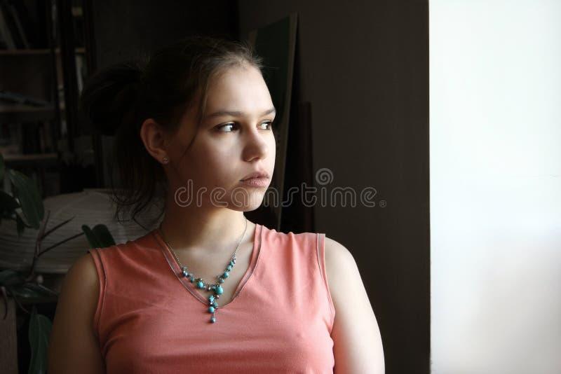 Adolescente infeliz pelo indicador imagens de stock royalty free