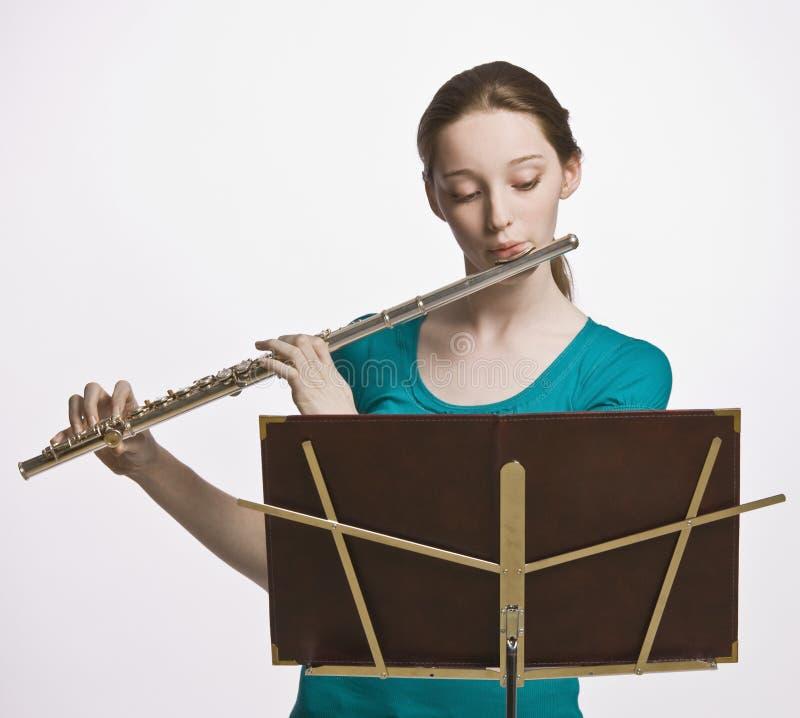 Adolescente jouant la cannelure photo libre de droits