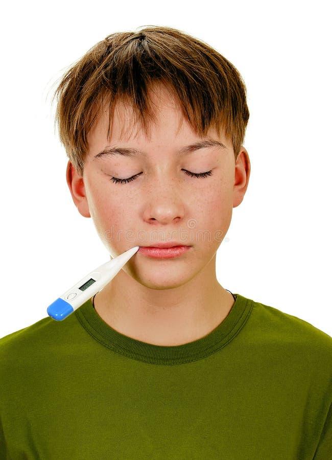 Adolescente malato con un termometro fotografia stock
