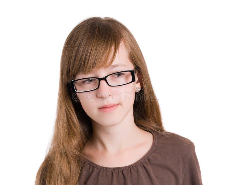 Adolescente nos vidros foto de stock