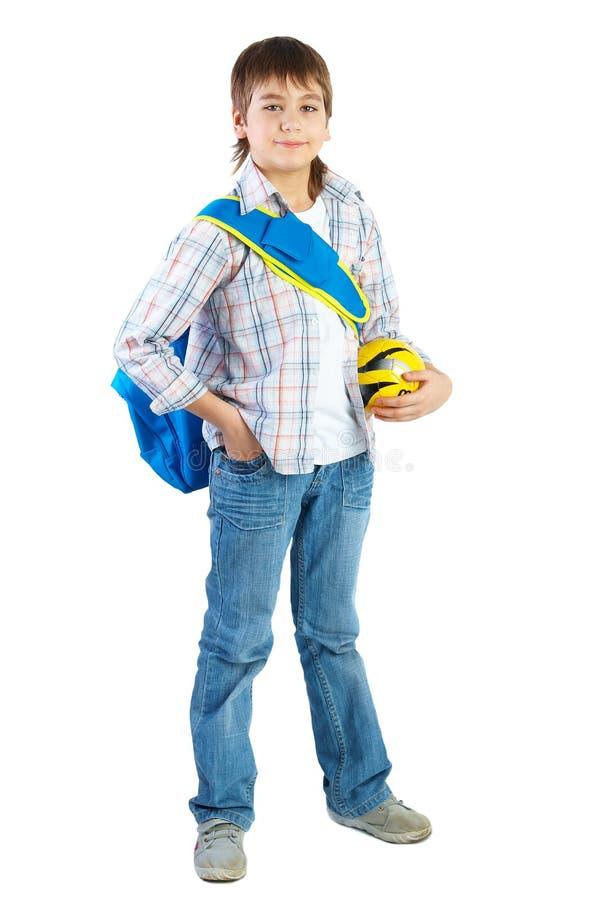 Adolescente novo com a esfera sobre o branco fotos de stock