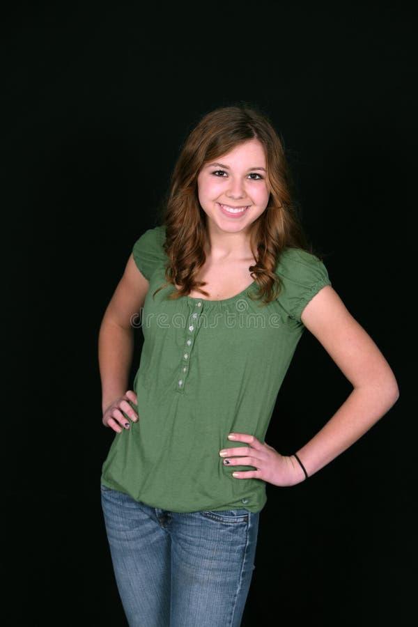 Adolescente novo na camisa verde fotografia de stock royalty free