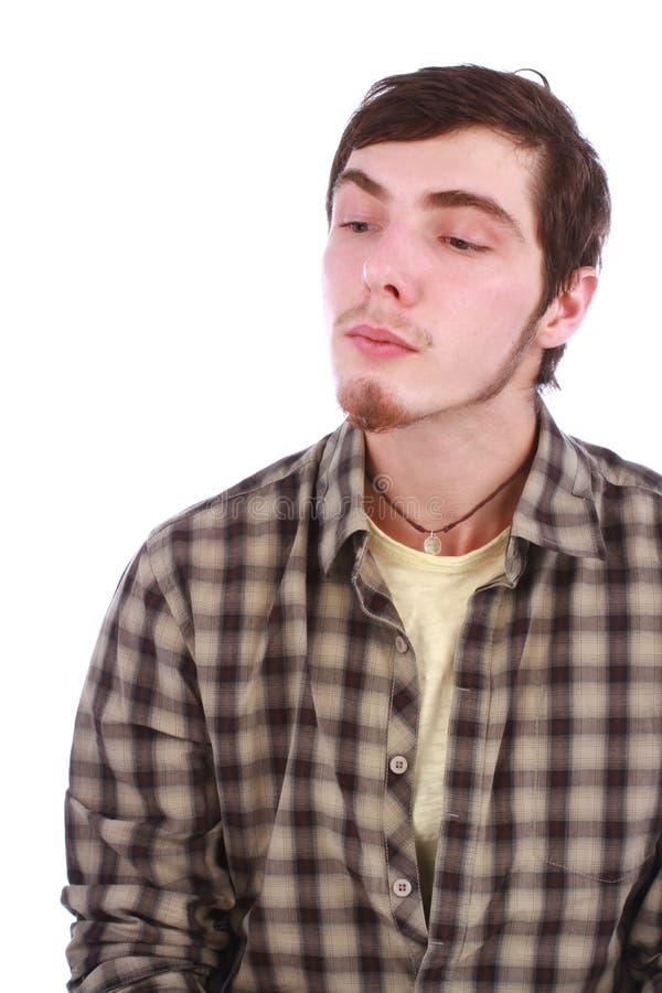 Adolescente novo que esconde e que olha para baixo foto de stock royalty free