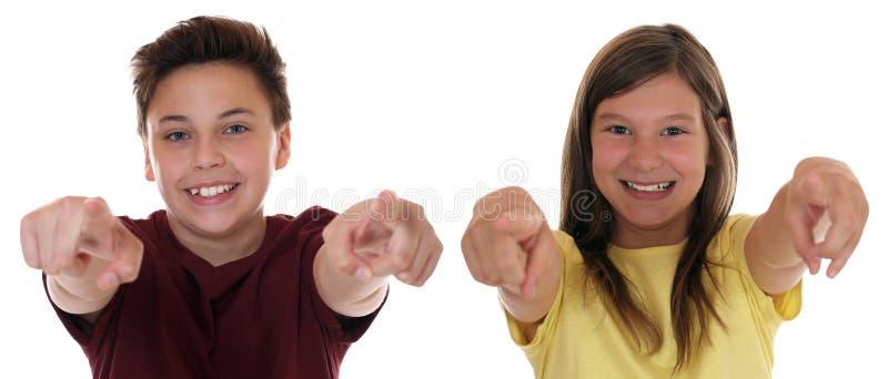 Adolescente ou as crianças novas que apontam com dedo eu quero-o foto de stock royalty free