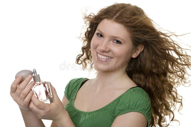 Adolescente pelirrojo con perfume fotos de archivo libres de regalías