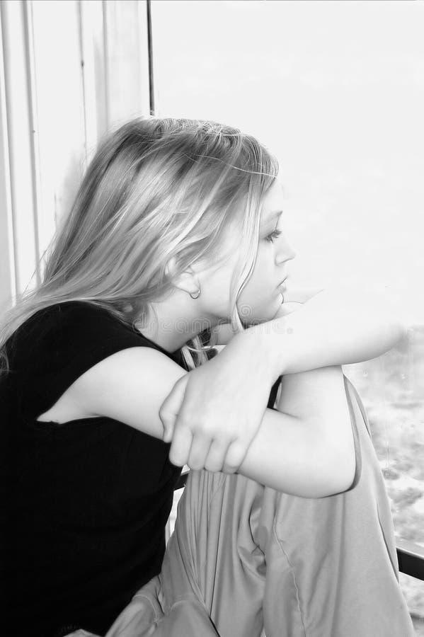 Adolescente preocupada foto de archivo