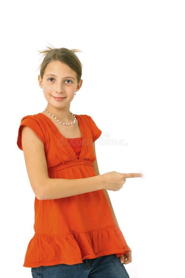 Adolescente que aponta no branco foto de stock