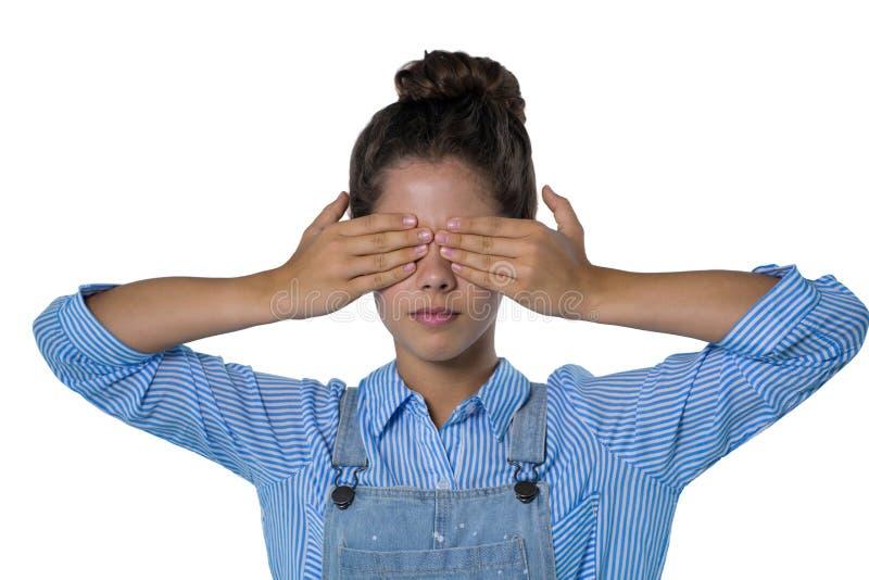 Adolescente que cobre seus olhos fotos de stock royalty free