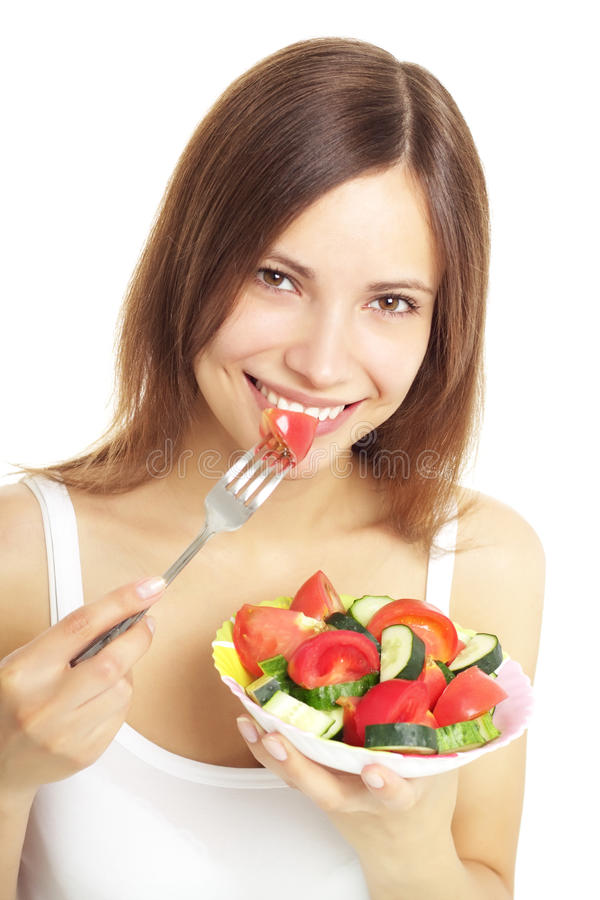 Adolescente que come a salada fresca fotografia de stock royalty free