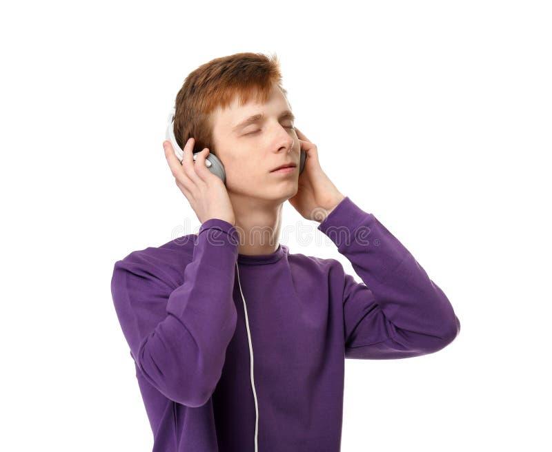 Adolescente que escuta a música fotografia de stock