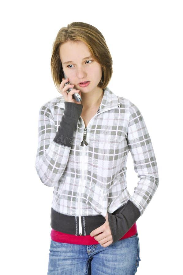 Adolescente que fala no telefone fotografia de stock