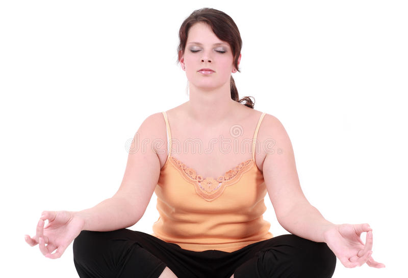 Adolescente que faz a ioga foto de stock