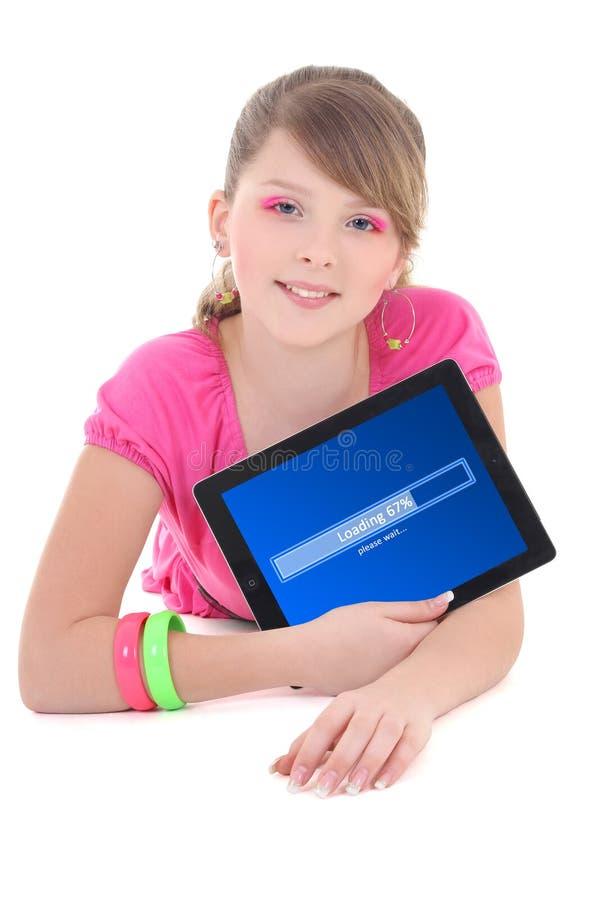 Adolescente que guarda o PC da tabuleta com imagem de stock royalty free