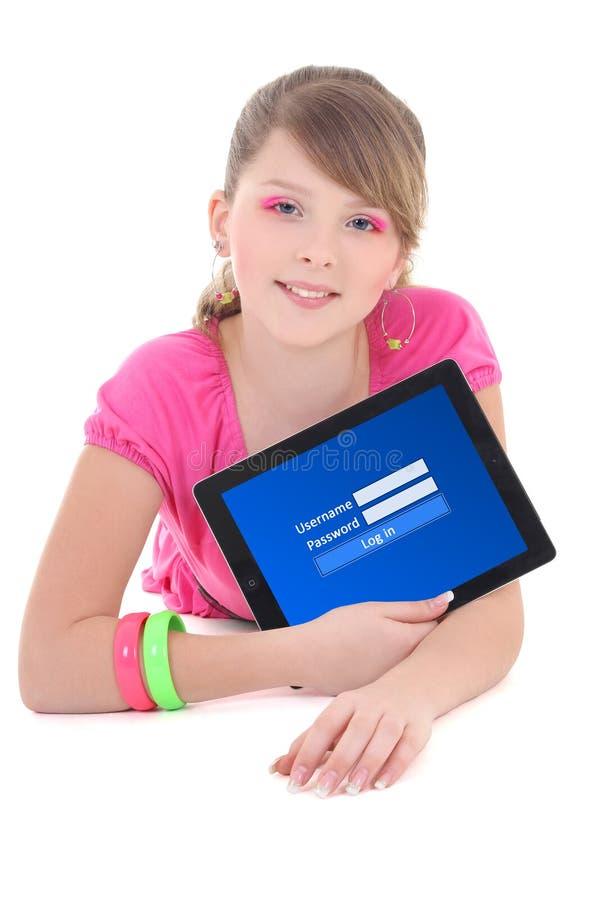 Adolescente que guarda o PC da tabuleta com formulário do início de uma sessão no isolado da tela foto de stock royalty free