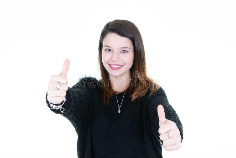Adolescente que mostra os polegares acima com ambas as m?os imagens de stock royalty free