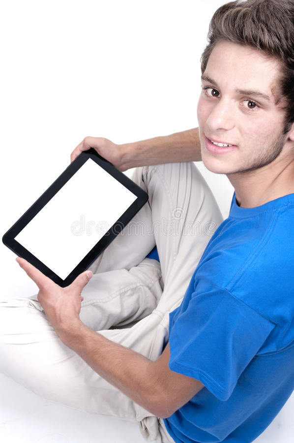 Adolescente que sostiene una tableta imagenes de archivo