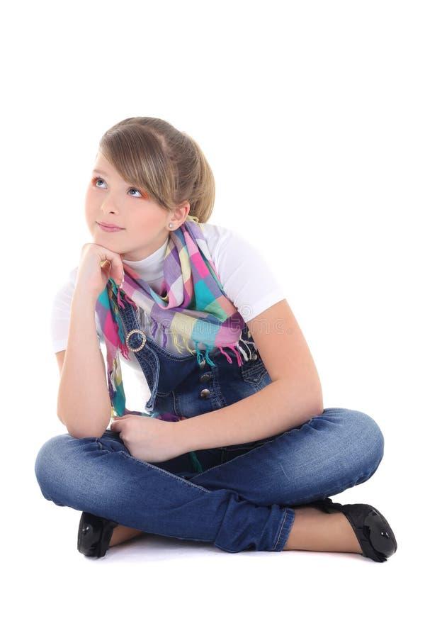 Adolescente rêvant au-dessus du blanc image stock