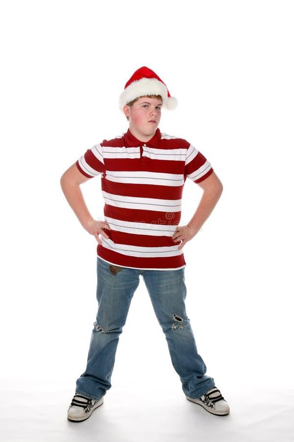 Adolescente rechoncho en camisa rayada y el sombrero de santa fotografía de archivo libre de regalías