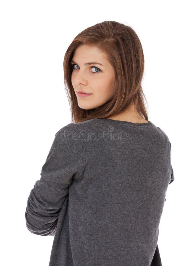 Adolescente regardant au-dessus de l'épaule images stock