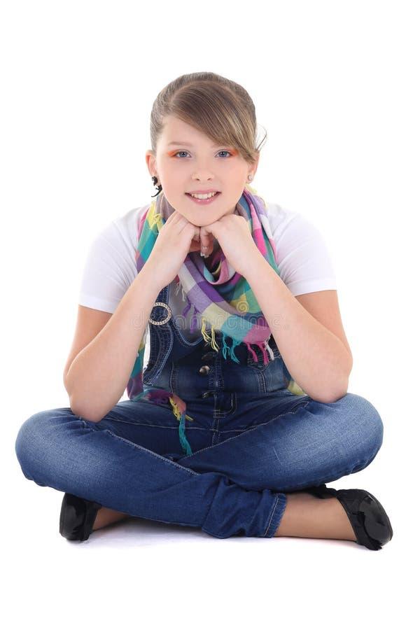 Adolescente s'asseyant au-dessus du blanc photographie stock libre de droits