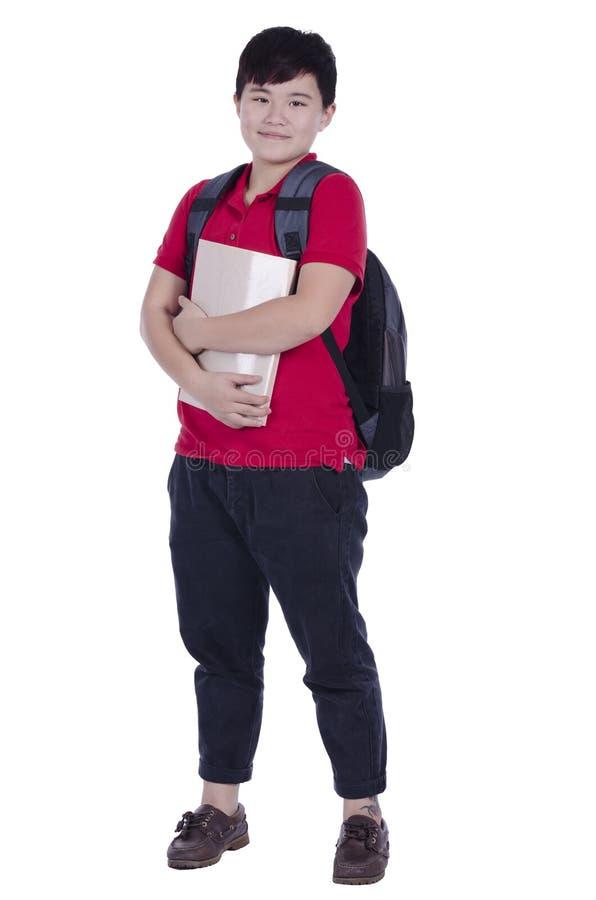 Adolescente sonriente con una cartera imagen de archivo