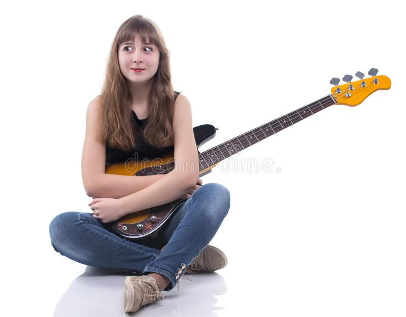 Adolescente surpreendido com guitarra-baixo imagem de stock