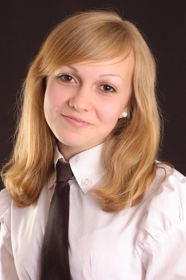 Adolescente in una camicia bianca fotografia stock