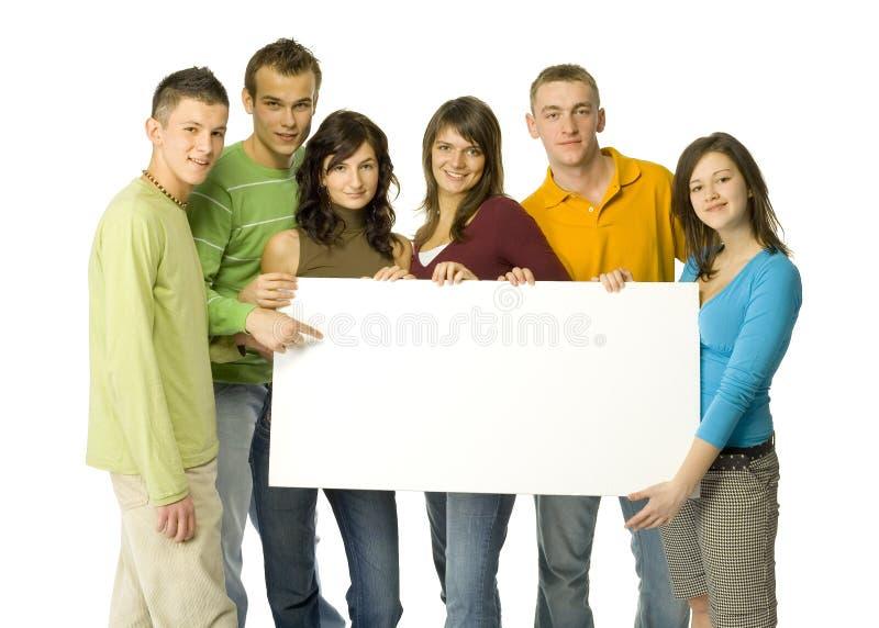 Adolescentes con la tarjeta imagen de archivo libre de regalías