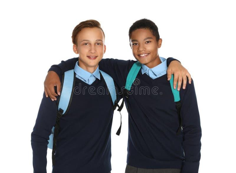 Adolescentes en uniforme escolar elegante fotografía de archivo libre de regalías
