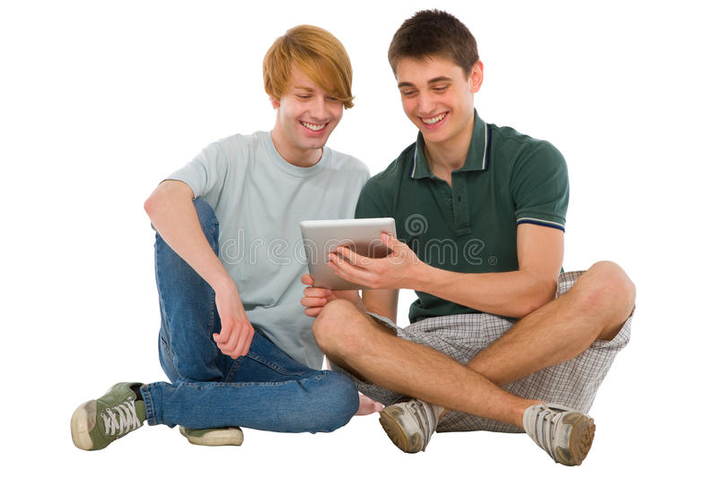 Adolescentes que usam a tabuleta fotos de stock royalty free