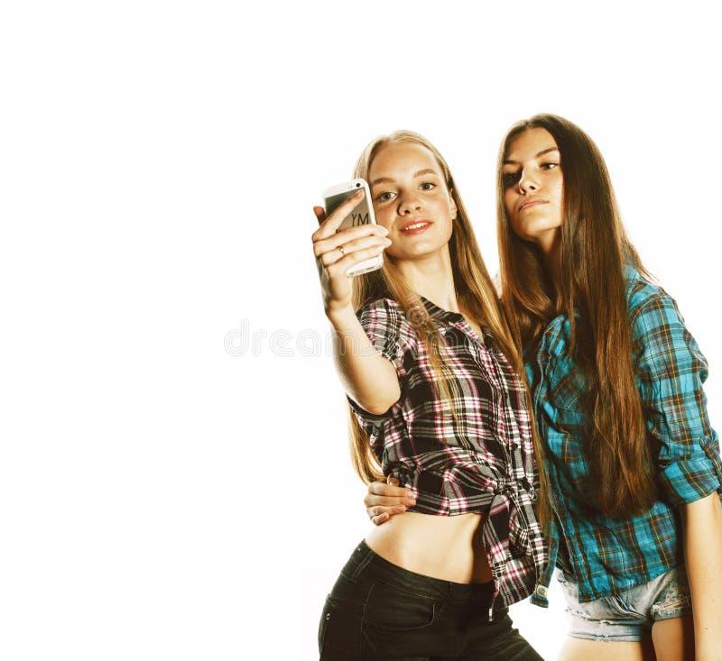 Adolescenti svegli che fanno selfie isolato fotografie stock