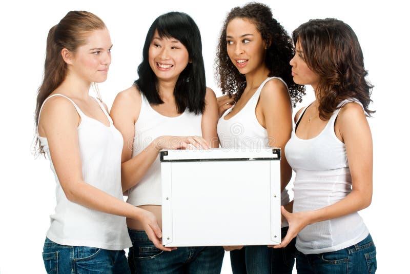 Adolescents divers avec le cadre blanc images stock