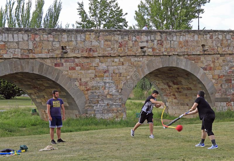 Adolescents are playing outdoor in public park of Salamanca. Salamanca, Spain - May 22, 2018: adolescents are playing outdoor in public park of Salamanca, Spain royalty free stock images