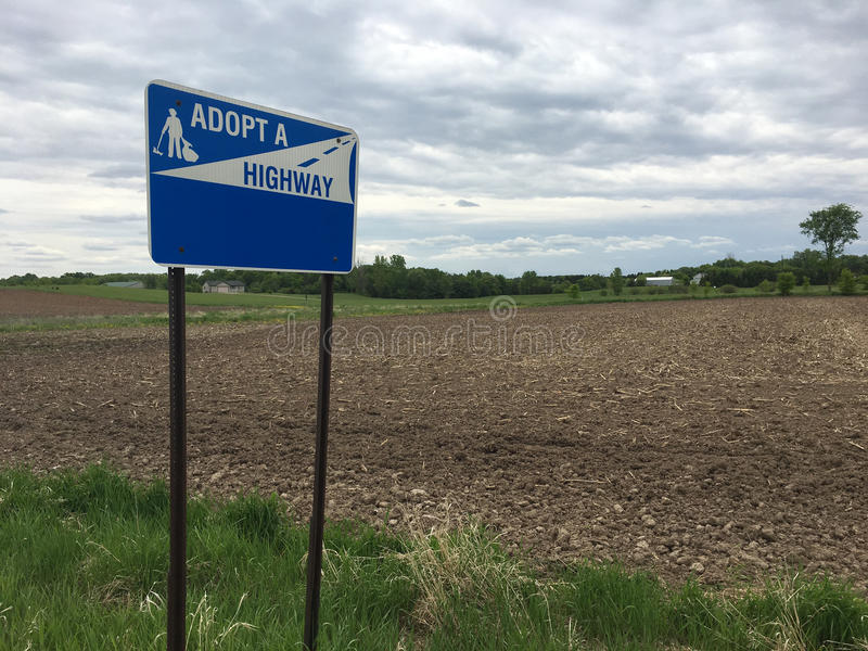Adopt a Highway Sign. Rural adopt a highway sign with space for copy royalty free stock photography