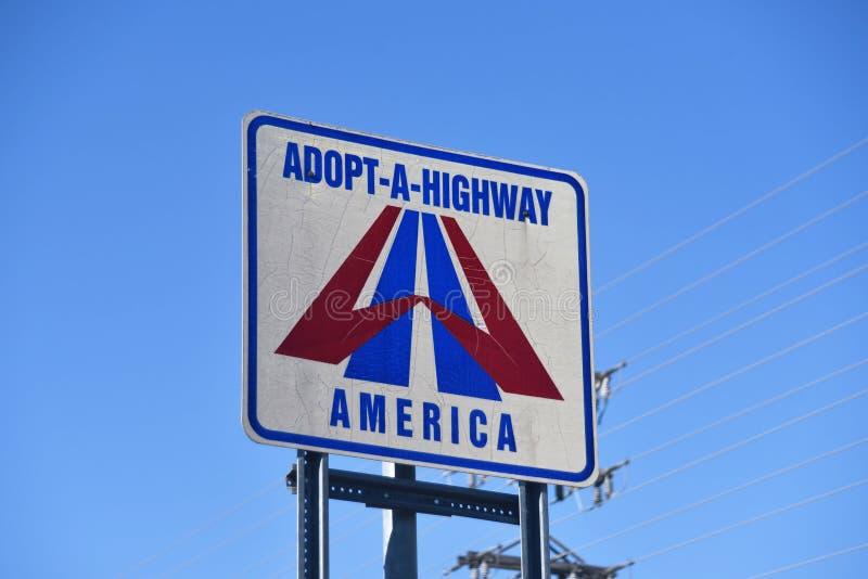 Adoptera-EN-huvudväg Amerika arkivfoto