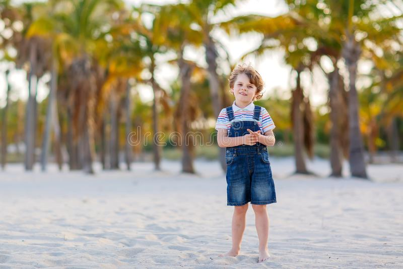 Cute Little Boy Having Fun At The Beach Stock Photo