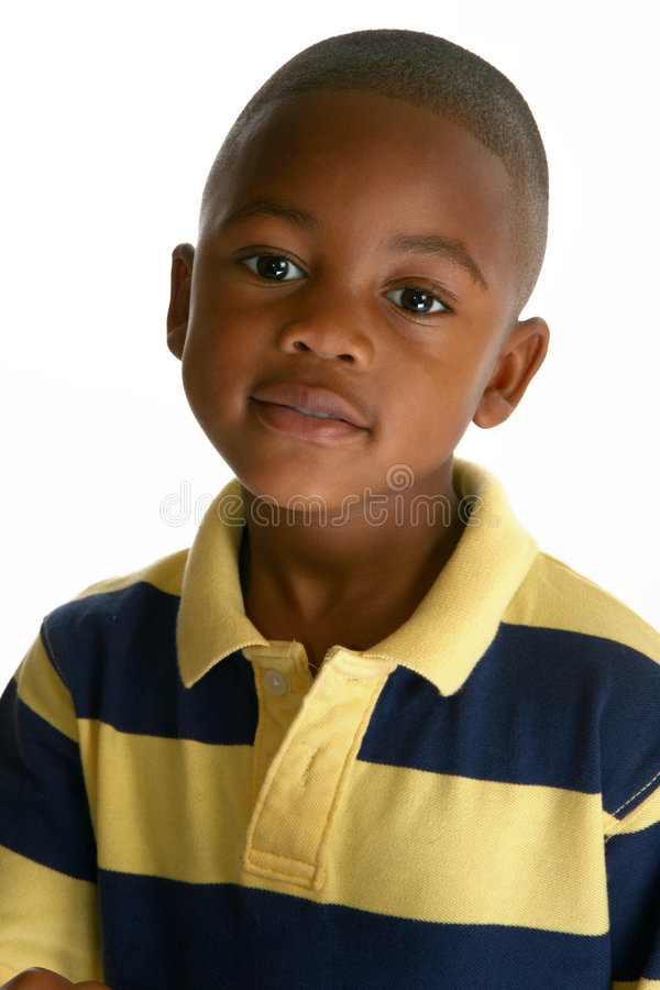 Adorable African American Boy. Adorable 5 year old African American boy against white background royalty free stock images
