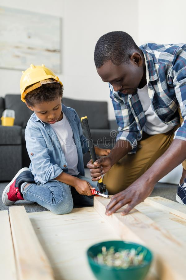 adorable african american father and little son stock photo