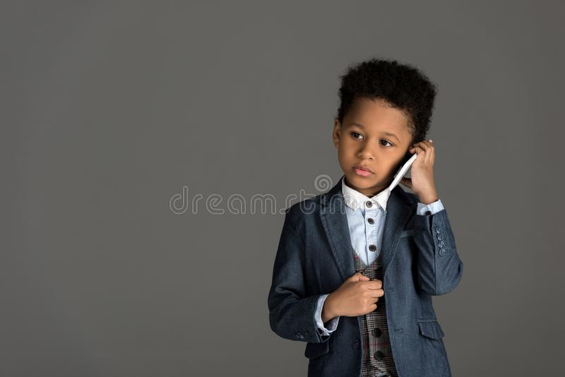 adorable african american kid talking by smartphone royalty free stock photos