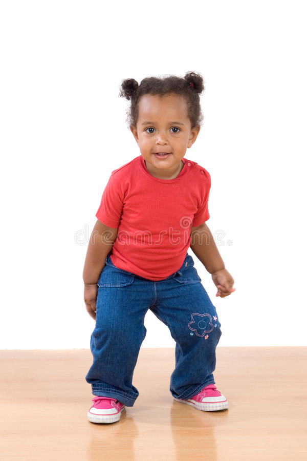 Adorable african baby dancing stock image