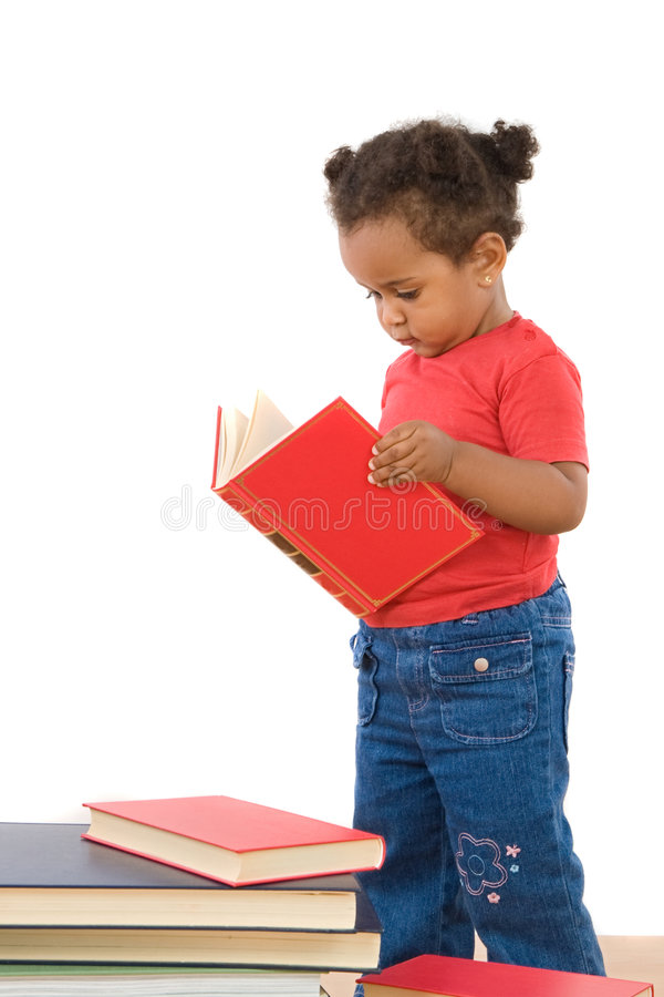 Adorable african baby reading stock image