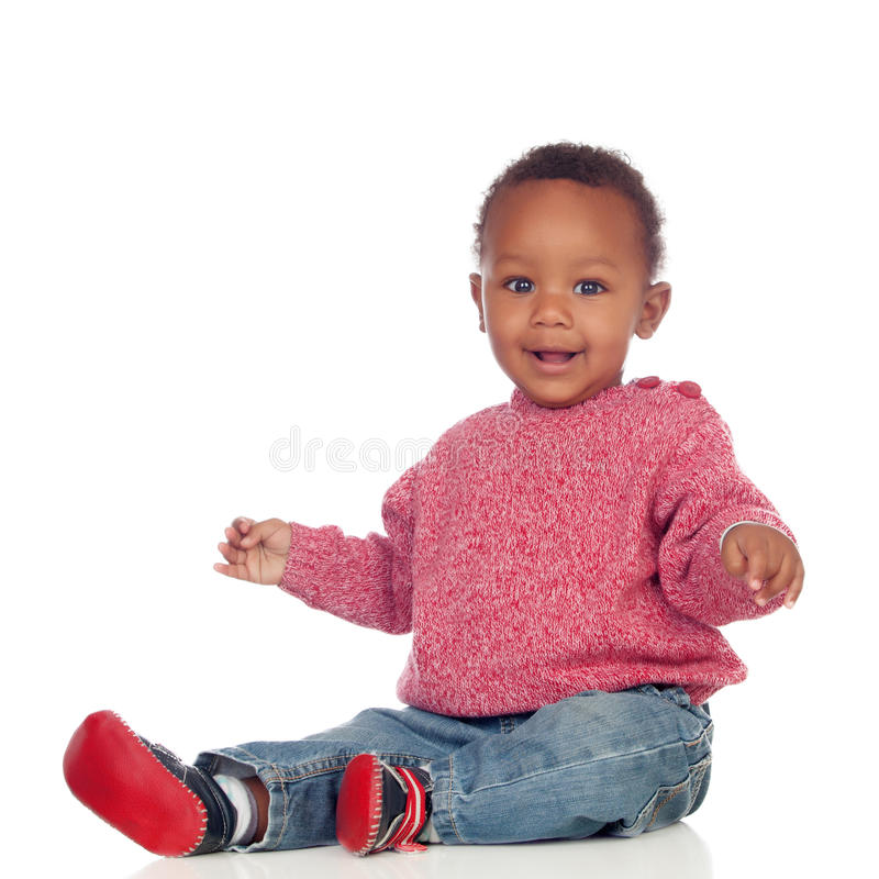 Adorable african baby sitting on the floor. Isolated on a white background stock images