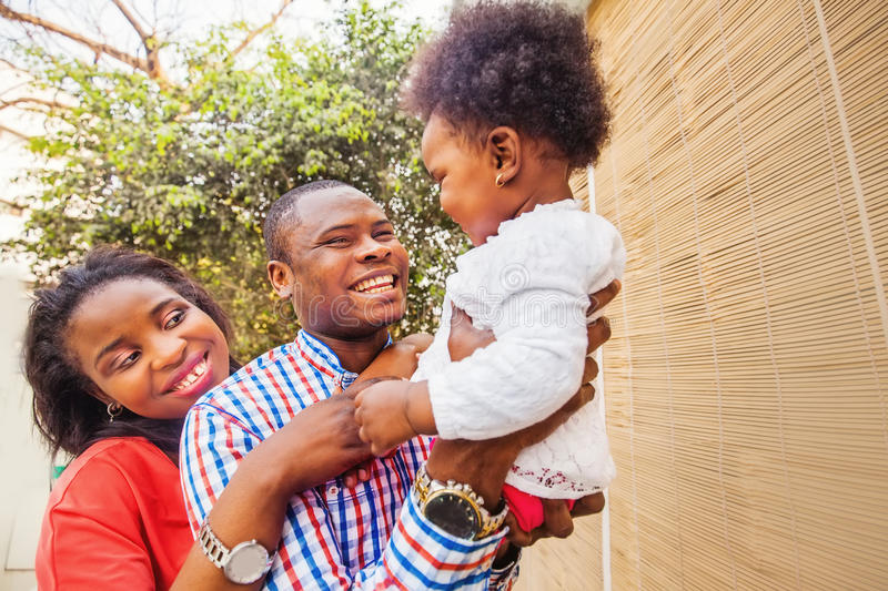 Adorable african family at balcony stock photography