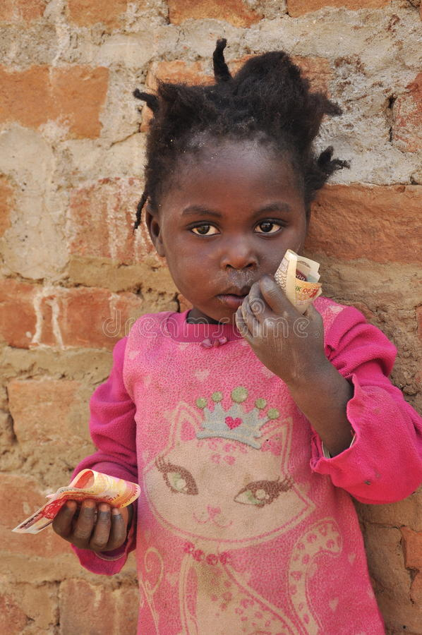 Download Adorable African Little Girl Holding Money Editorial Photography - Image: 21320782