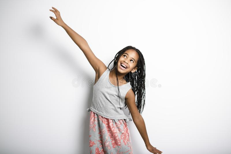 Adorable african little girl on studio gray background stock photos